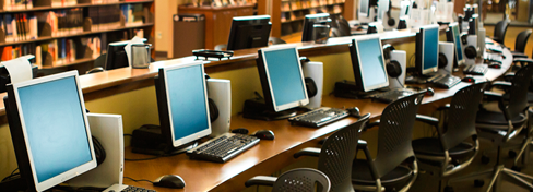 Row of computers for accessing digital content.
